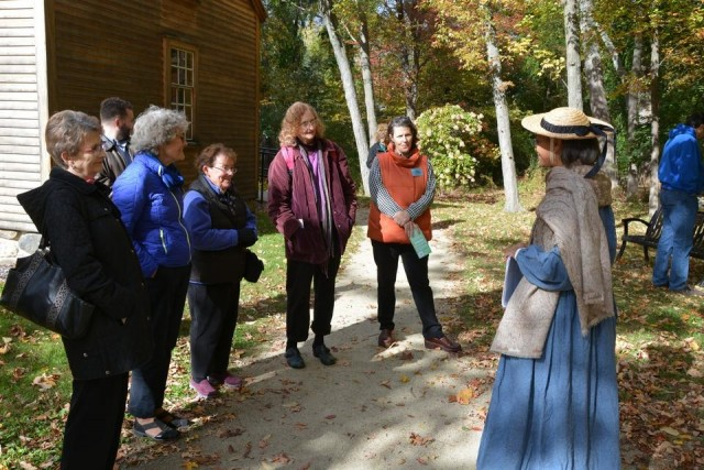Maria Madison In Blue, As Ellen Garrison, Greeting Visitors To The Robbins House On A Recent Fall Day.