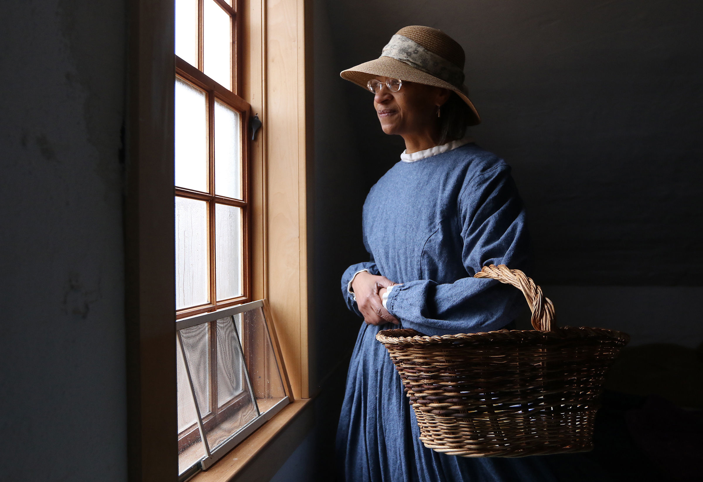 Maria Madison portrays Ellen Garrison at The Robbins House in Concord Friday, Feb. 16, 2018. Born in the house in 1823, Garrison went on to a life as an activist for African American rights. Students from Greenfield Commonwealth Virtual School went to the house to learn about the families who lived there and Concord's African American history. [Wicked Local Staff Photo/Ann Ringwood]
